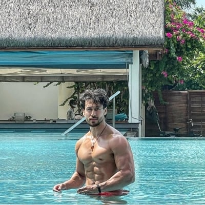 Tiger Shroff flaunts his perfect washboard abs in pool picture