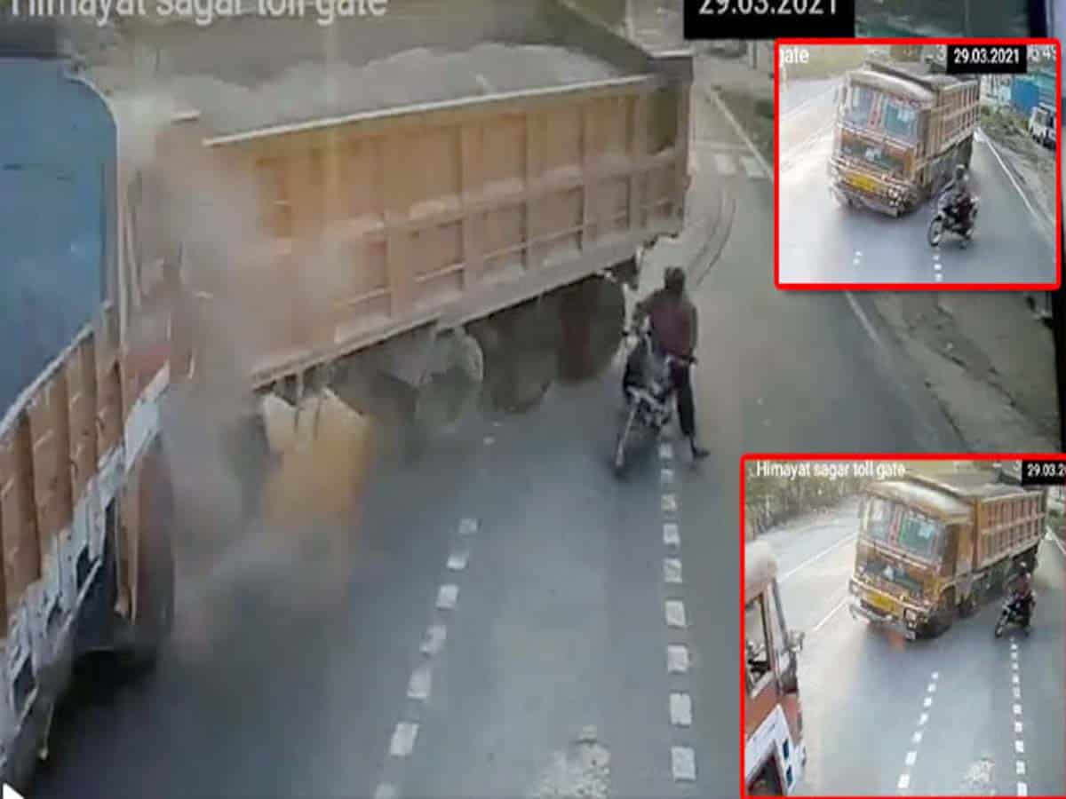 Negligence of bike rider results in collision of two lorries in Cyberabad