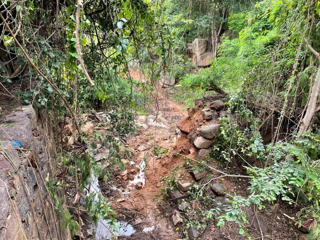 GHMC's earth movers damage Golconda fort's historic moat during nala work