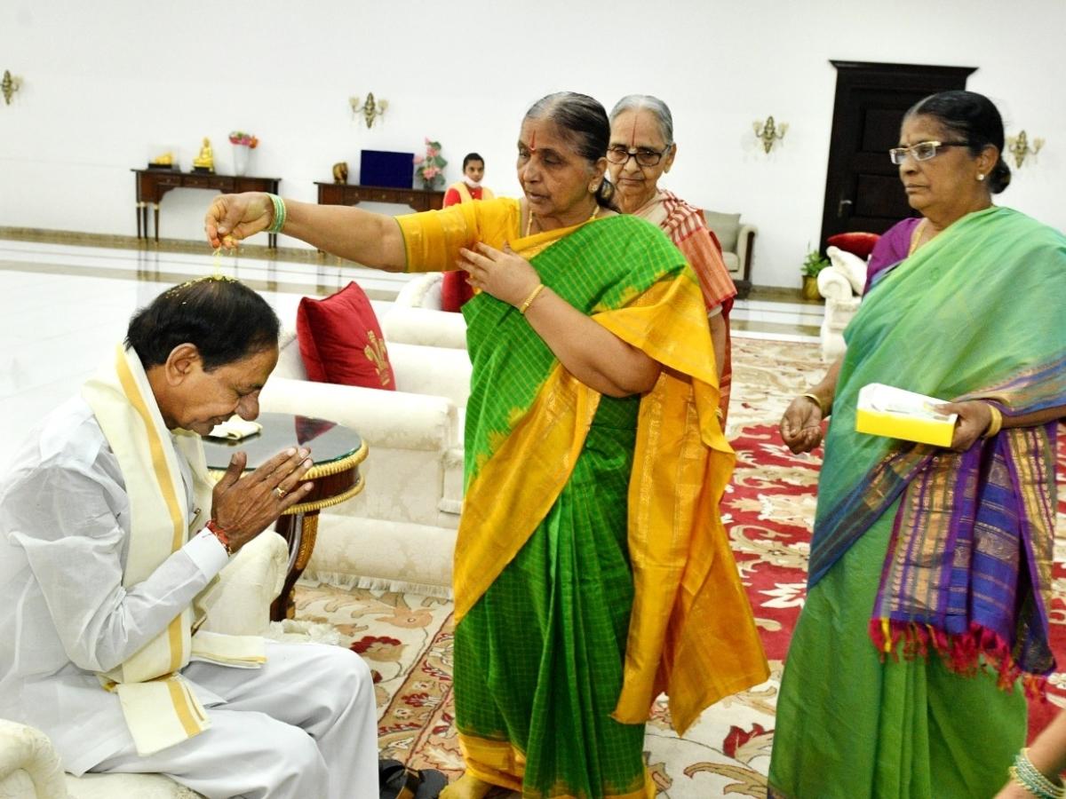 Sisters tie rakhis to Telangana CM